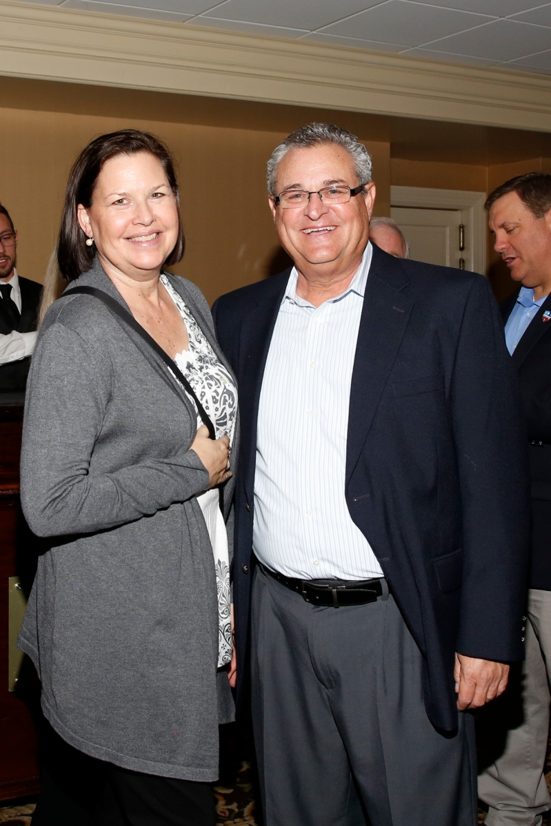Sheila Dufresne, wife of 2013 President Chris Dufresne, and Larry Wahl of the Orange Bowl at the FWAA's Past Presidents Dinner on Jan. 6, 2017, in Tampa. Photo by Melissa Macatee.