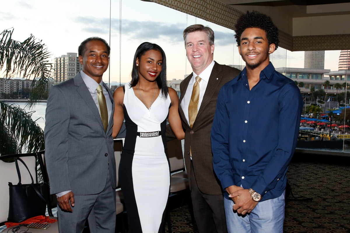 Eddie Robinson III, grandson of the namesake of the Eddie Robinson Coach of the Year Award, and his children Chloe and Eddie IV with this year's winner of the award, Colorado Coach Mike MacIntyre, on Jan. 7, 2017, in Tampa. Photo by Melissa Macatee.