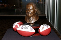 The FWAA Eddie Robinson Coach of the Year Award and commemorative footballs. Photo by Melissa Macatee.