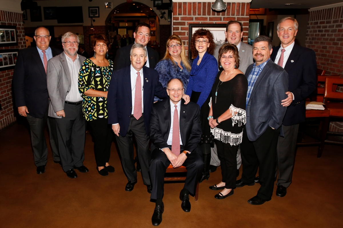 Charlie Fiss (seated), winner of the 2017 Bert McGrane Award, surrounded by friends and co-workers at the FWAA Awards Breakfast on Jan. 9, 2017, in Tampa. Photo by Melissa Macatee.