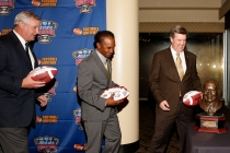 Chuck Lapeyre of the Sugar Bowl, Eddie Robinson III and Colorado Coach MIke MacIntyre at the FWAA Eddie Robinson Coach of the Year Reception on Jan. 7, 2017, in Tampa. Photo by Melissa Macatee.