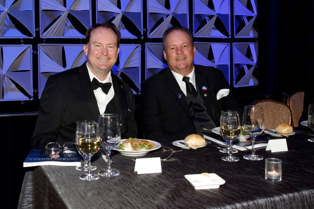 Mark Anderson (left) sits on the dais at the National Football Foundation Dinner on Dec. 6 in New York. FWAA member Ed Grom of the American Sports Network is seated beside Mark. (Photo Courtesy of the NFF)