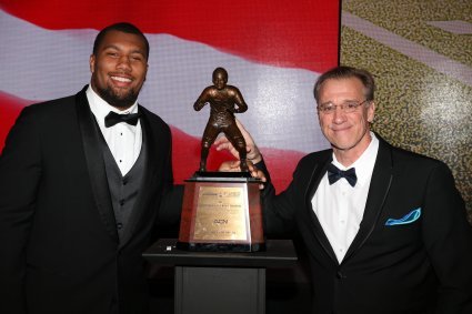2017 Bronko Nagurski Award winner Bradley Chubb of North Carolina State and FWAA president Dave Jones. Photo by Michael Strauss.