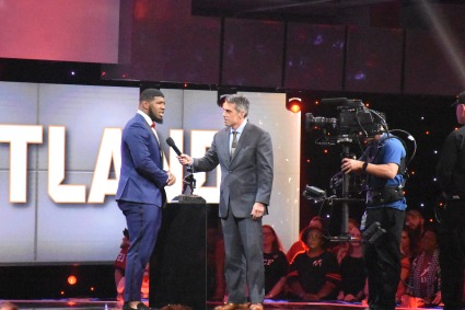 Ed Oliver of the University of Houston is interviewed by ESPN's Chris Fowler after receiving the 2017 Outland Trophy at the College Football Awards Show. Photo by Andy Crawford.