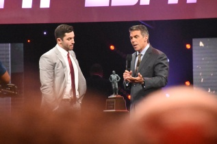 Baker Mayfield, the FWAA's first-team All-America quarterback, speaks with ESPN's Chris Fowler after receiving the Maxwell Award at the College Football Awards Show. Photo by Andy Crawford.