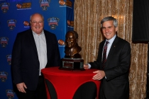 (Left) Paul Hoolahan, Sugar Bowl CEO, and Stanley Cohn, President of the Sugar Bowl Committee, pose with the Eddie Robinson bust. Photo by Melissa Macatee.
