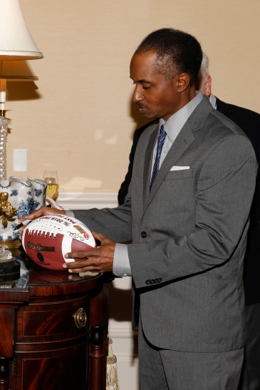 Eddie Robinson III autographs a commemorative football. Photo by Melissa Macatee.