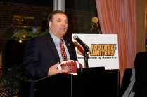 Mike Griffith receives the FWAA Beat Writer of the Year Award. Photo by Melissa Macatee.