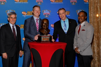 Left to right, Stanley Cohn (Sugar Bowl), Coach of the Year Scott Frost, 2017 FWAA President Dave Jones and Eddie Robinson III. Photo by Melissa Macatee.