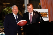 FWAA Past President Tony Barnhart presents the FWAA's Lifetime Achievement Award to Mike Finn of the ACC. Photo by Melissa Macatee.
