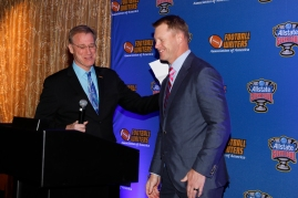 2017 FWAA President Dave Jones welcomes Scott Frost to the podium to receive the FWAA Eddie Robinson Coach of the Year trophy. Photo by Melissa Macatee.