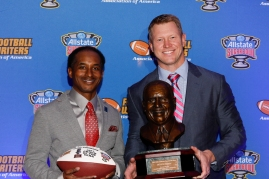 Eddie Robinson III and Scott Frost with the FWAA Eddie Robinson Coach of the Year Award. Photo by Melissa Macatee.