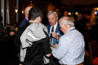 Past President Scott Bohls (right) interviews former Virginia Tech coach Frank Beamer. Photo by Melissa Macatee.