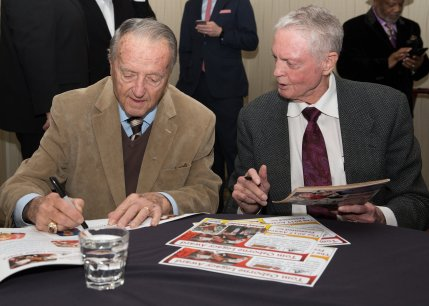 Former Florida State coach Bobby Bowden and former Nebraska coach Tom Osborne autograph programs before the Outland Trophy presentation dinner. C41Photography.