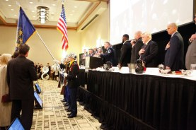 The audience rises for the national anthem at the Outland Trophy presentation dinner. C41Photography.