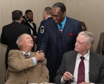 Former Florida State coach Bobby Bowden shakes hands with Nebraska's 1972 Heisman Trophy winner, Johnny Rodgers, as former Nebraska coach Tom Osborne looks on. C41Photography.