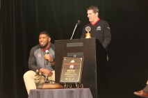 Outland winner Ed Oliver takes a question while Bob Mancuso of the Greater Omaha Sports Committee looks on from the podium. The Outland Trophy and the Tom Osborne Legacy Award are in the foreground. C41Photography.