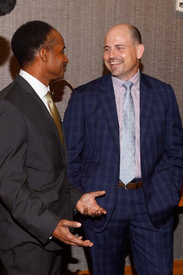 Eddie Robinson III (left) confers with UAB's Bill Clark. (Photo by Melissa Macatee)