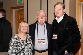 FWAA members Doug Kelly (center) and Mark Purdy (right) along with Kelly's wife at the FWAA Eddie Robinson Coach of the Year reception. (Photo by Melissa Macatee)