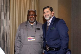 The College Football Playoff's Alfred White and the NFF's Matt Sign enjoy a moment at the reception. (Photo by Melissa Macatee)