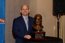 2018 Coach of the Year, UAB's Bill Clark, with Eddie Robinson bust. (Photo by Melissa Macatee)