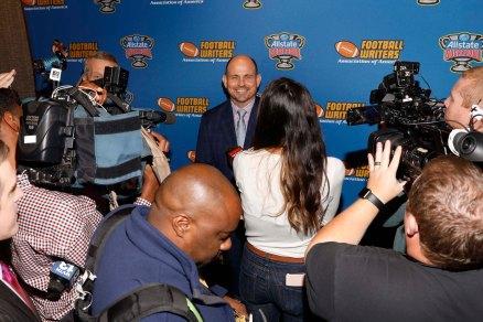 FWAA Eddie Robinson Coach of the Year Award receipient Bill Clark meets the media at reception at San Jose Marriott. (Photo by Melissa Macatee)