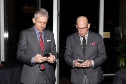 USA Today's George Schroeder and CBSSports.com's Dennis Dodd check their messages. (Photo by Melissa Macatee)