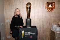 FWAA's Margaret Mason poses with College Football Playoff Championship Trophy. (Photo by Melissa Macatee)