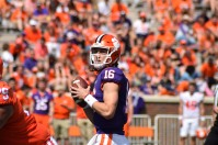 Clemson quarterback Trevor Lawrence, the first winner of the Shaun Alexander/FWAA Freshman of the Year Award, drops back to pass in Clemson's 2019 spring game. Alexander honored Lawrence with the trophy at the game. Photo by Mike Griffith.