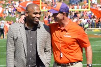 Former Alabama and NFL running back Shaun Alexander is greeted by Clemson coach Dabo Swinney at the school's 2019 spring game. Alexander was there to formally present the first Shaun Alexander/FWAA Freshman of the Year Trophy to Clemson quarterback Trevor Lawrence. Photo by Shane Sandefur.