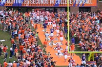 Clemson players and coaches come down the ramp into the stadium for the school's 2019 spring game. Photo by Shane Sandefur.