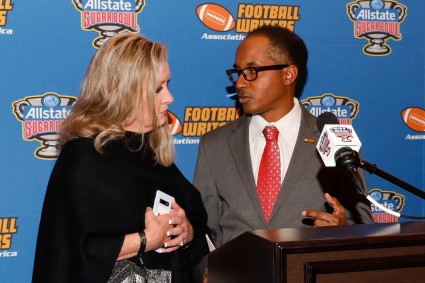 Margaret Mason of the FWAA with Eddie Robinson III. (Photo by Melissa Macatee)