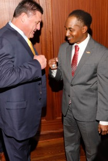 LSU Coach Ed Orgeron and Eddie Robinson III exchange a fist bump before the award presentation. (Photo by Melissa Macatee)