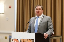 Mike Griffith announced the FWAA/Shaun Alexander Freshman All-America Team. (Photo by Melissa Macatee)